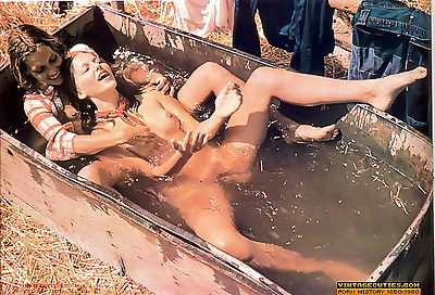 Two young lesbians playing in a village tub with cold water - part 921
